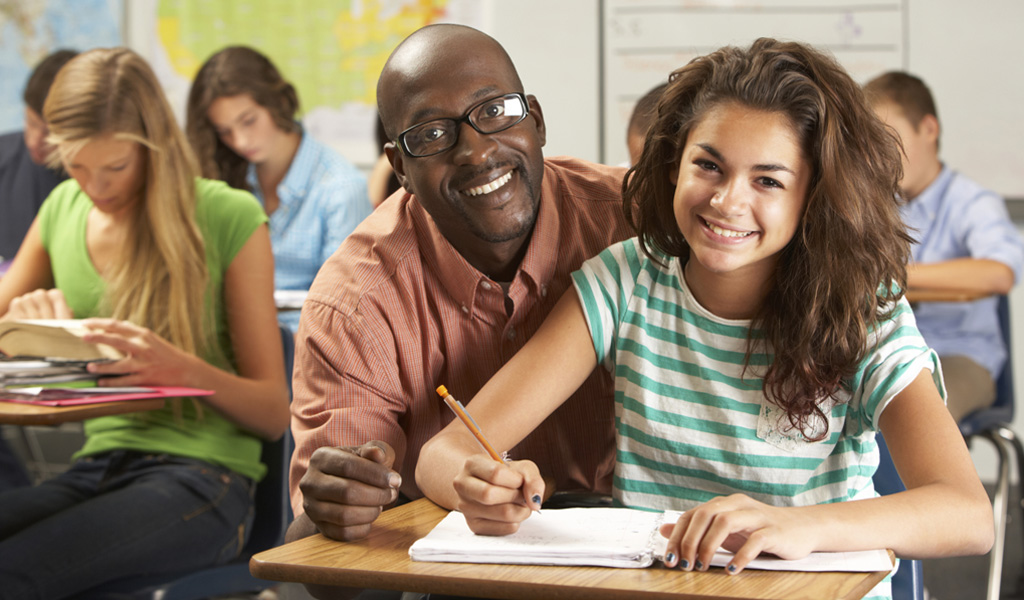 ADHD Strategies: A teacher helping a student with ADHD using the appropriate teaching strategies