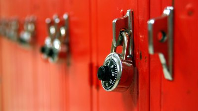 Red lockers with combination locks on them in middle school of ADHD student