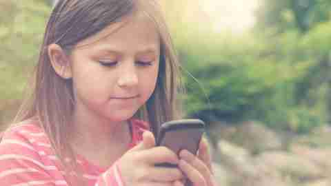 Girl with ADHD using mobile apps for behavior