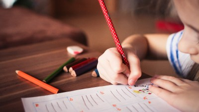 Enhance your ADHD child's study space, like this girl doing her homework