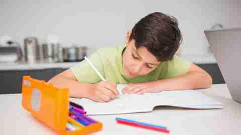 Boy with ADHD writing