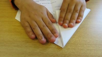 Disruptive kid making a paper plane