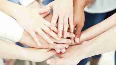Hands of ADHD students on top of each other