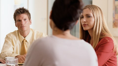 Three people discussing common IEP problems during a meeting