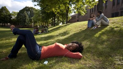 Teen girl laying on grass, pondering advice she has received
