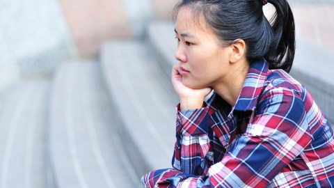 A girl looking sad and wondering about advice for depressed teens