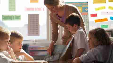 A teacher working with her students, some of who have ADHD, on utilizing organizational tools