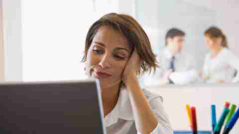 A woman looking up ADHD organizational tools on her laptop computer