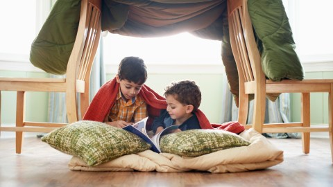 Children use their creativity to build a fort.