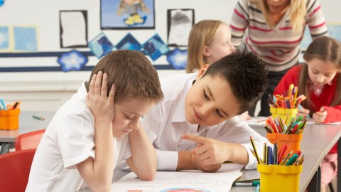 Two children working on managing their behavior in the classroom