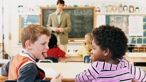 Two children struggling to manage their behavior in the classroom