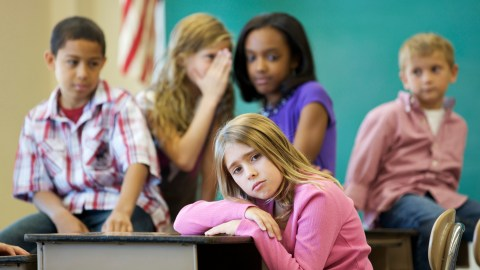 Girls bullying another girl, the result of poor classroom behavior management
