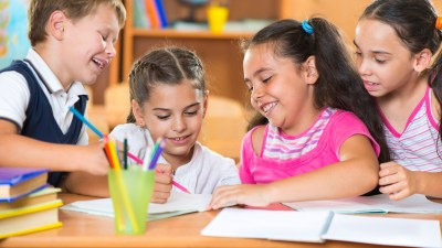Young children working together in the classroom on behavior management