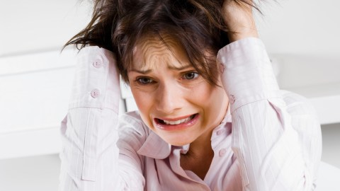 A stressed ADHD woman has a panic attack