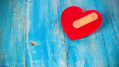 A red heart with a Band-Aid that represents the damage that hurtful comments can do to a child with ADHD