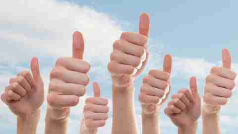 Collection of people showing thumbs up to celebrating learning how to stop anxiety
