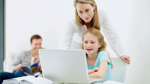 A mom and her daughter research ADHD using a laptop after being diagnosed