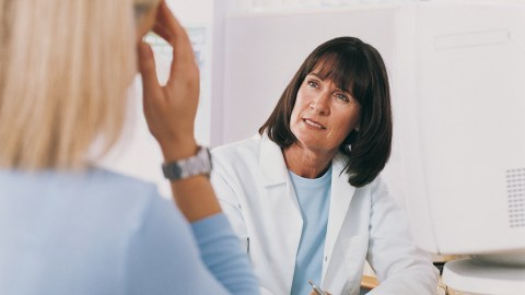 A doctor listens to a woman with ADHD talk about her symptoms