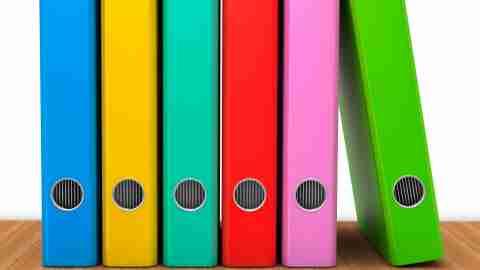 Colored binders in a row, filled with ADHD coping skills
