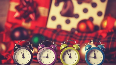 Four clocks in a row, a reminder for an adult with ADHD to stop wasting time