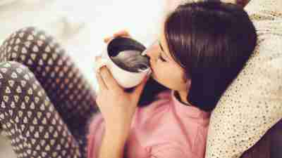 An overwhelmed mom takes 10 minutes for herself to have a cup of coffee.