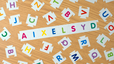 alphabetical letters with dyslexia inscription made of puzzle-style tiles.