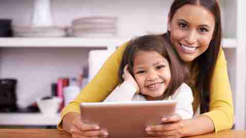 A mother and daughter looking up facts about Tourette Syndrome on a tablet