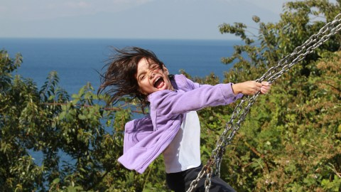 A girl with SPD on a swing.
