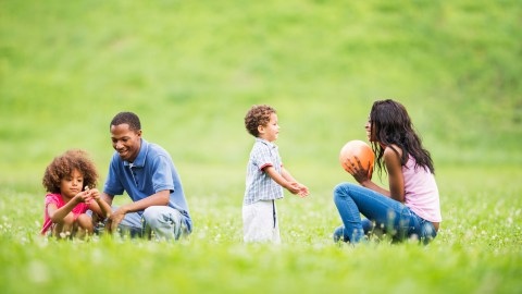 A family with SPD plays in the park.