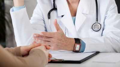 Doctor discussing the side effects of ADHD medication with a patient