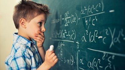 Boy with ADHD struggling with a math problem at the beginning of the new school year