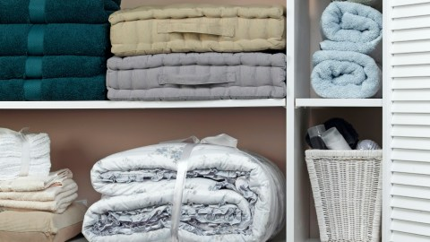 An organized linen closet in the home of a person with ADHD