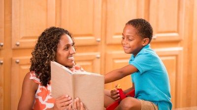 Parent reading a book to her child after a parent-teacher conference