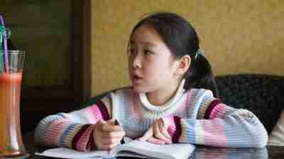 A young girl experiencing frustration during homework time