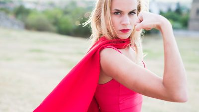 A woman posing as a superhero, a symbol for how celebrities with ADHD think of themselves