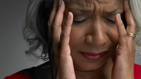 """A woman closes her eyes and wonders, """"How does ADHD medication work?"""""""