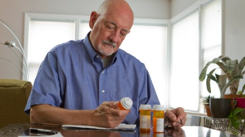 """An older man looks at prescription bottles and wonders, """"How does ADHD medication work?"""""""