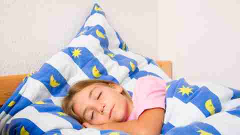 A girl sleeps peacefully after learning how ADHD medications work.
