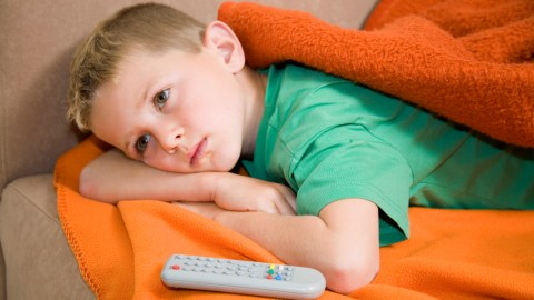 Boy watching TV as part of a reward system for good behavior