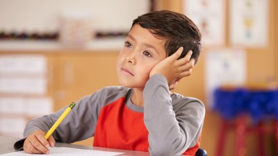 A boy with ADHD and anxiety daydreaming in class