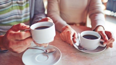 Close-up of couple with ADHD drinking coffee