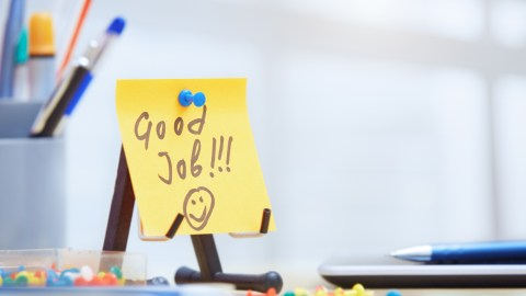 A supportive post-it note on the desk of a person with ADHD