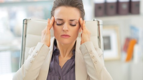 Woman with ADHD is stressed at work because she is hypersensitive.