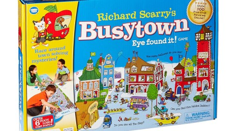 Kids with ADHD play with a Busytown game they received as a gift.