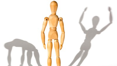 Conceptual representation of bipolar disorder vs. ADHD, wooden doll and his shadow