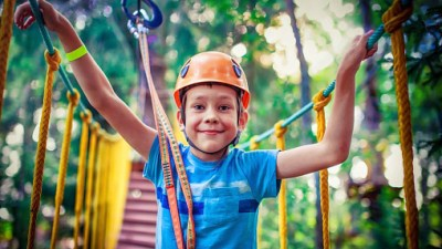 happy boy on the zipline