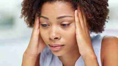 ADHD woman has headache which may be caused by her ADHD medication