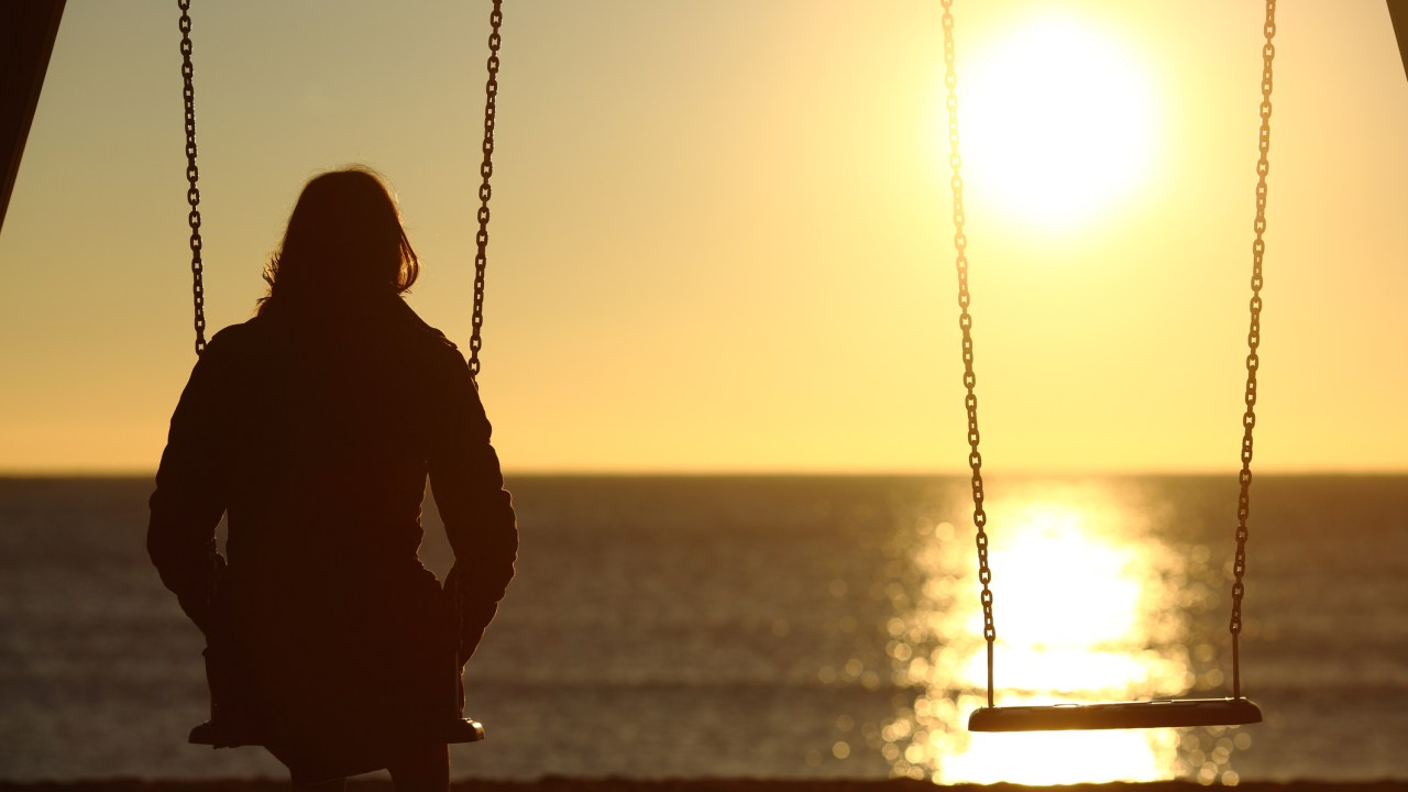ADHD woman alone on swings