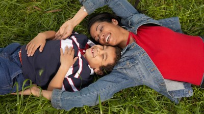 Mother and her ADHD son lying on the grass