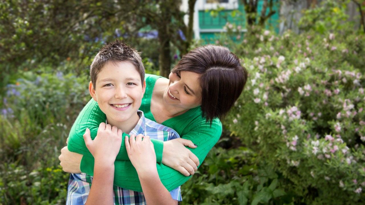 Mother and ADHD son embrace
